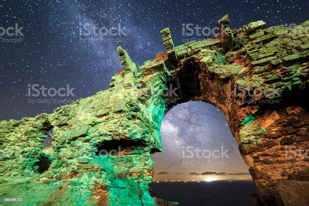 Milky way view from old ruined stone gate stock photo
