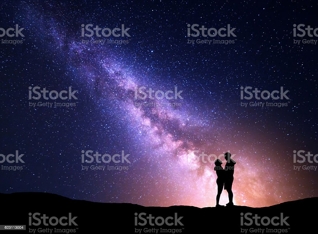 Milky Way with silhouette of people. Landscape with night sky stock photo