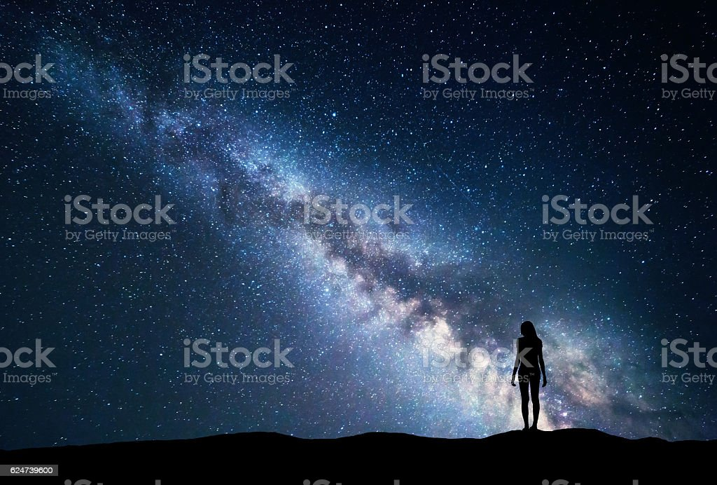 Milky Way with standing woman. Night landscape stock photo