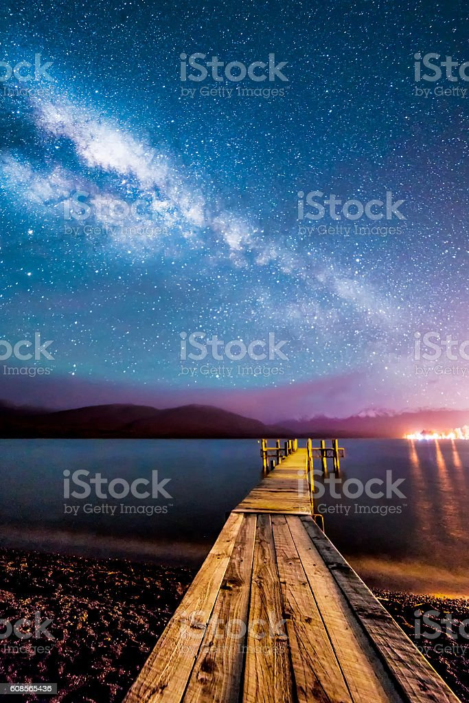 Milkyway with wooden jetty stock photo