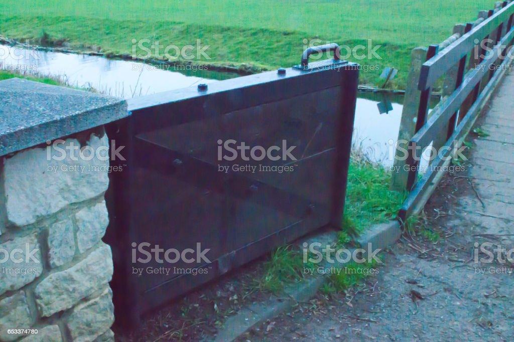 Mill stream flood barrier in Stamford stock photo
