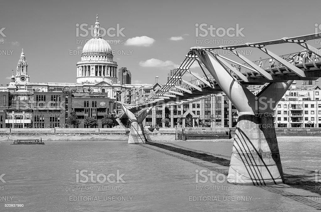 Millenium bridge across river Thames stock photo