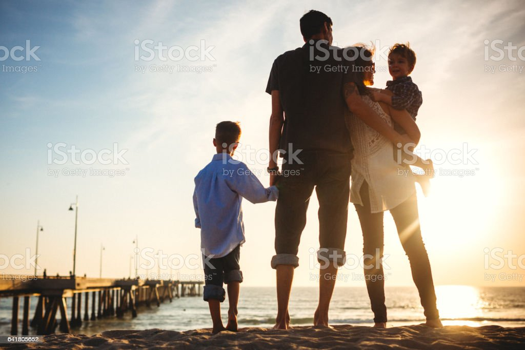 Millennial Family At the Beach stock photo