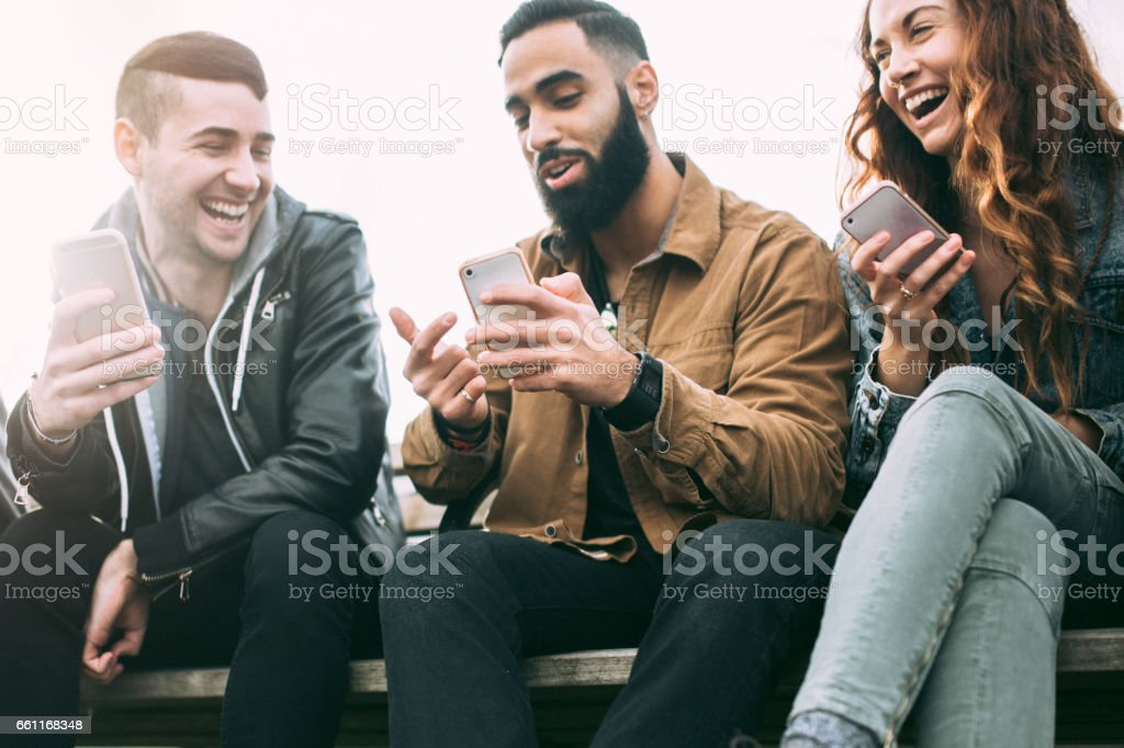 Millennial Friends on Smart Phones stock photo