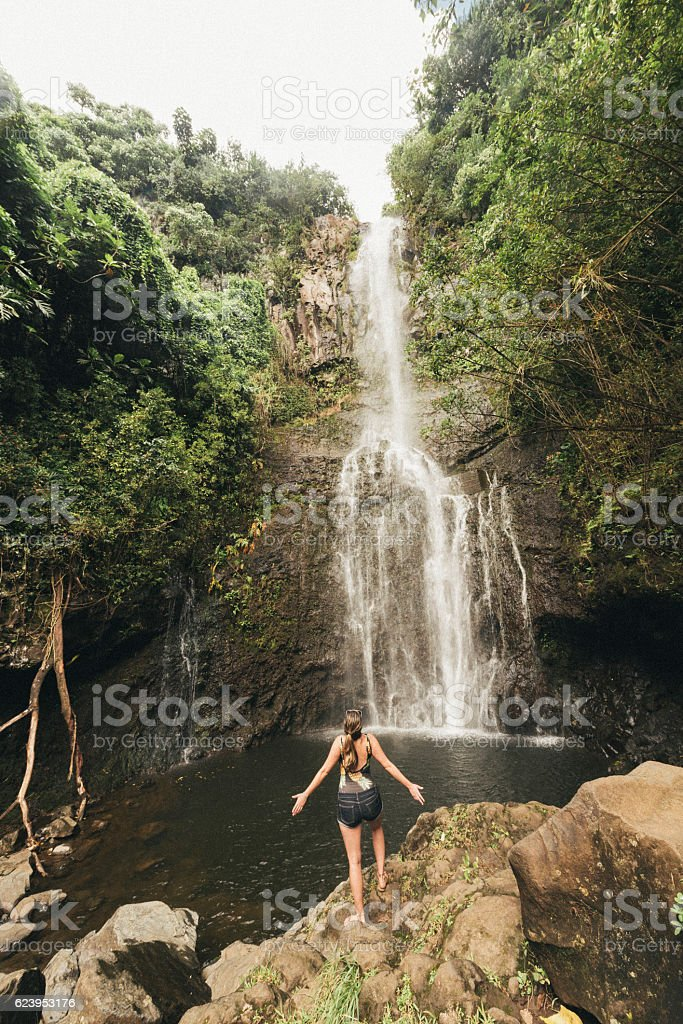Millennial Woman Hikes Scenic Nature Trail Travel Destination Hawaii stock photo