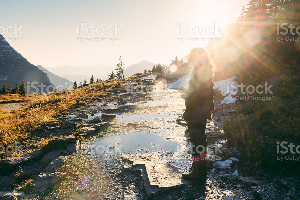 Millennial Woman on Scenic Hike in Montana Glacier National Park stock photo