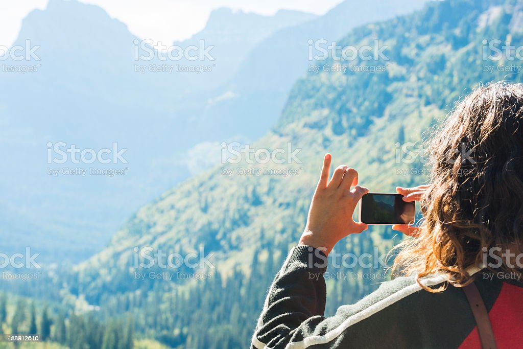 Millennial Woman Takes Pictures at Scenic Nature Travel Destination Montana stock photo