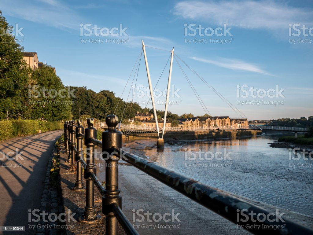 Millennium bridge Lancaster and River Lune with blue sky and railing stock photo