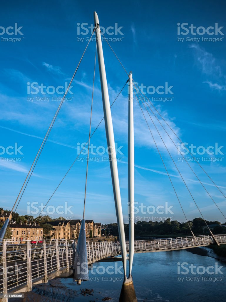 Millennium bridge Lancaster and River Lune with blue sky stock photo
