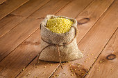 Millet in bags on a wooden table