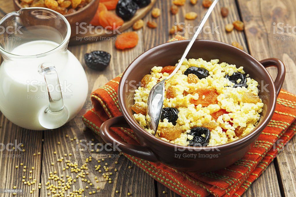 Millet porridge with dried fruit royalty-free stock photo