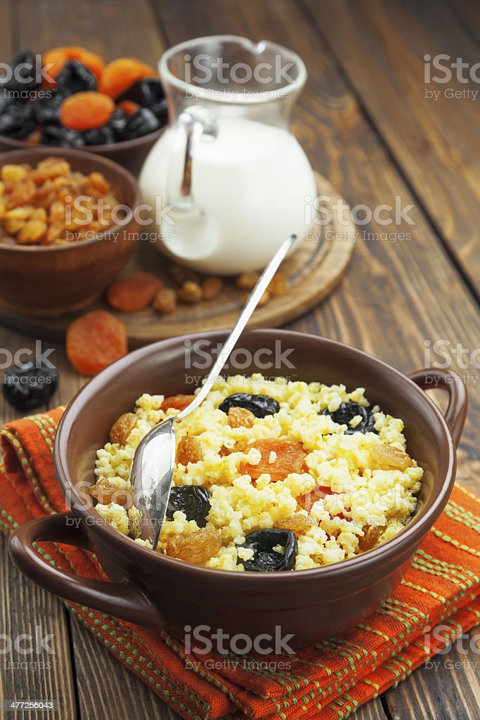 Millet porridge with dried fruit royalty-free stock photo