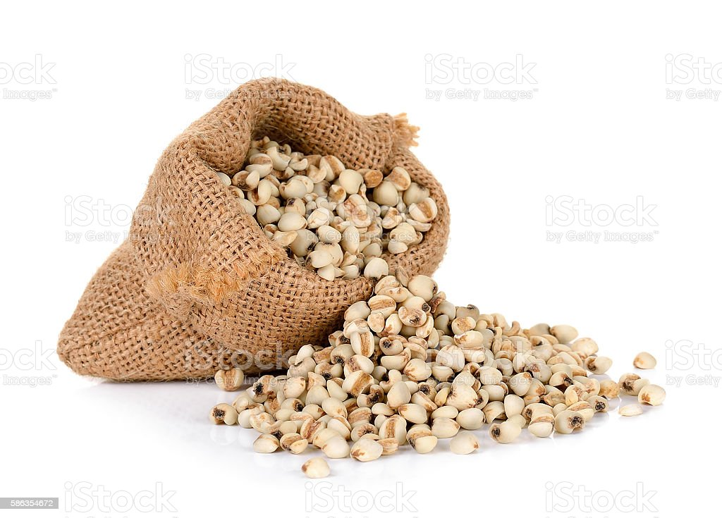 Millet rice , millet grains wiht sack isolated stock photo