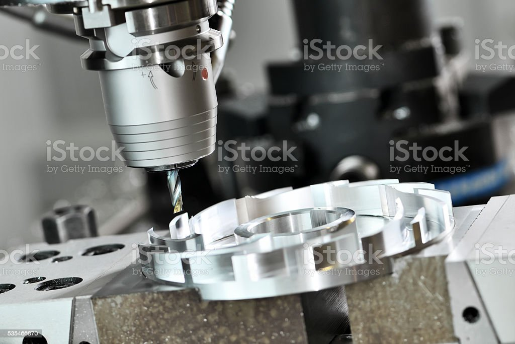 CNC milling cutting process. metalwork machining by mill cutter stock photo