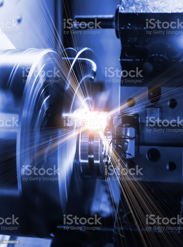 milling detail on metal cutting machine tool at factory stock photo