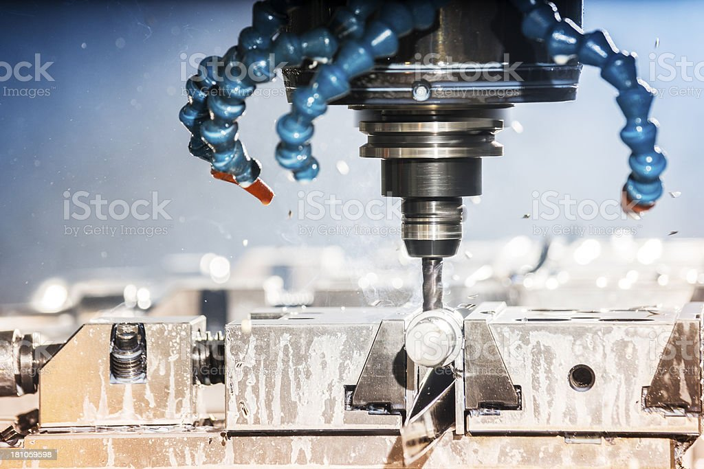 Milling machine, machining metal in a factory royalty-free stock photo