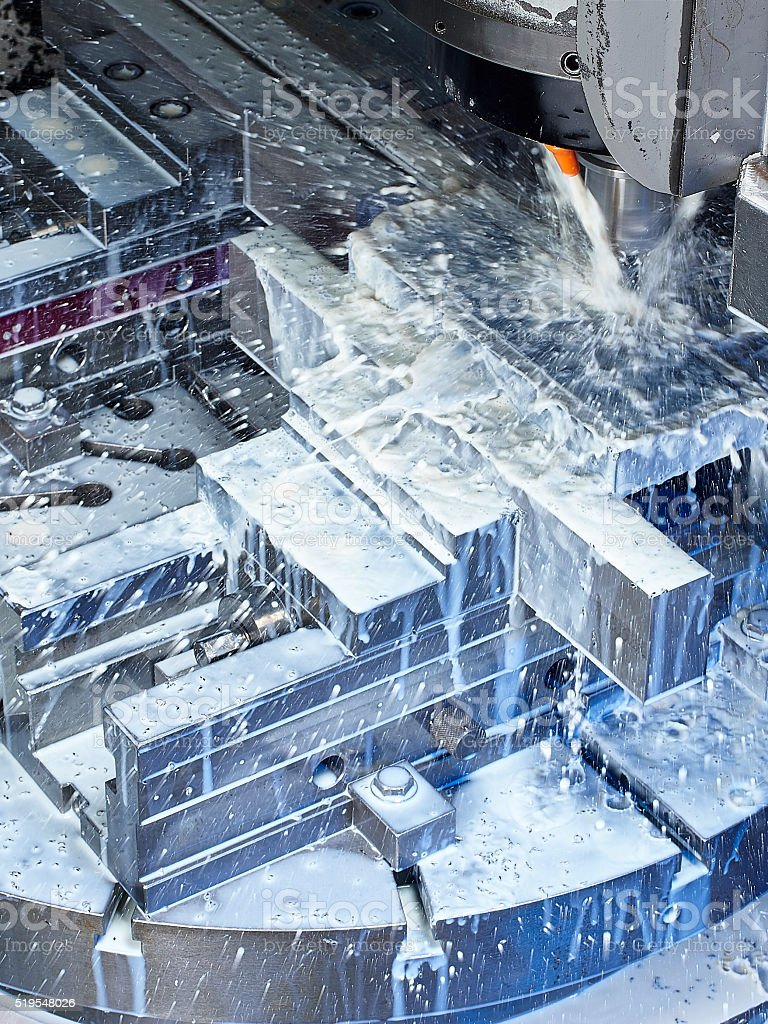 Milling machine pouring water close up stock photo