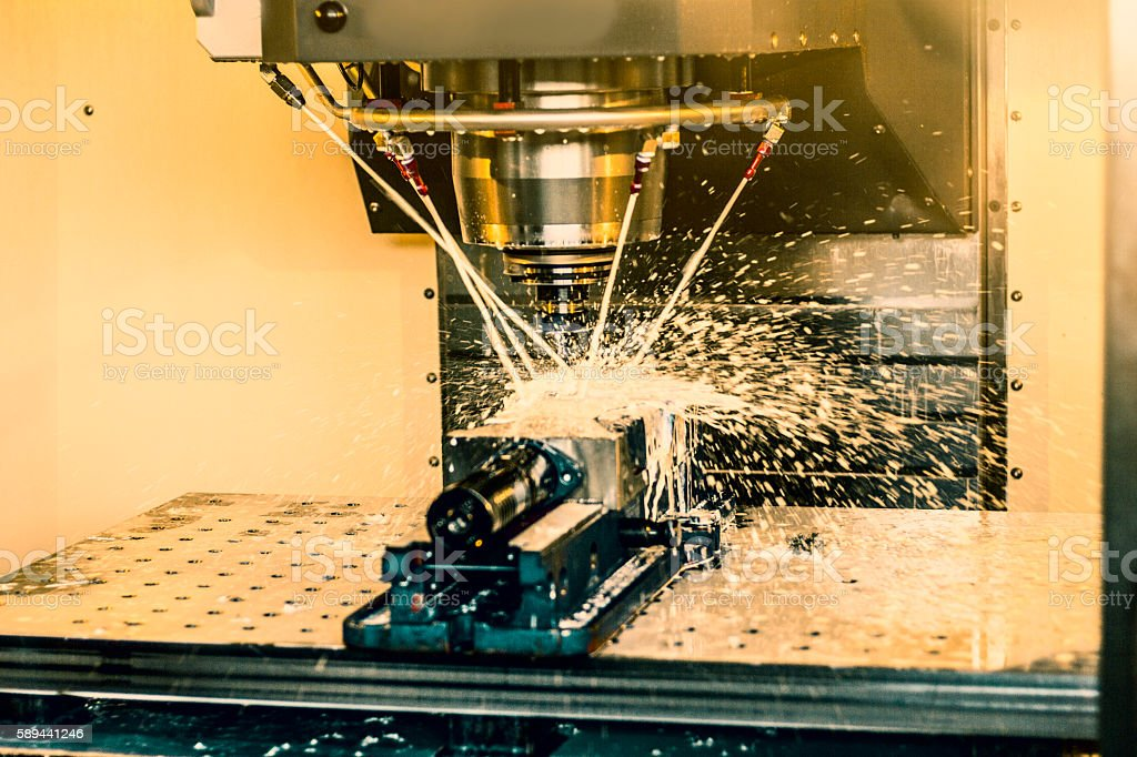 CNC milling machine with coolant at tool workshop. stock photo