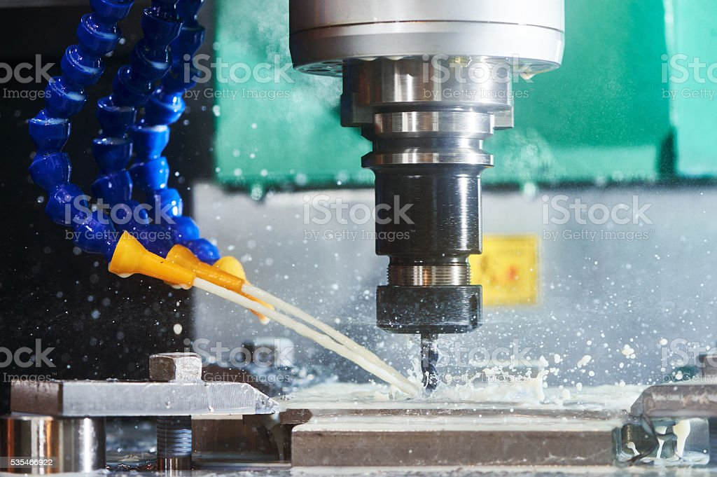 Milling metalwork process. CNC metal machining by vertical mill stock photo
