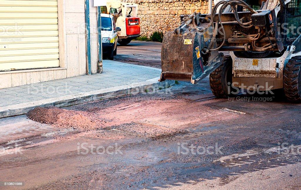 Milling of asphalt for road reconstruction stock photo