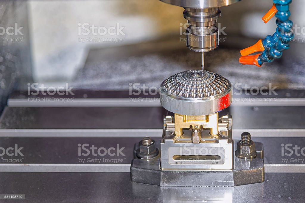 CNC Milling operation on the sample work pieces stock photo