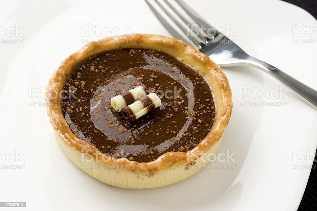 Millionaires chocolate and caramel tart royalty-free stock photo