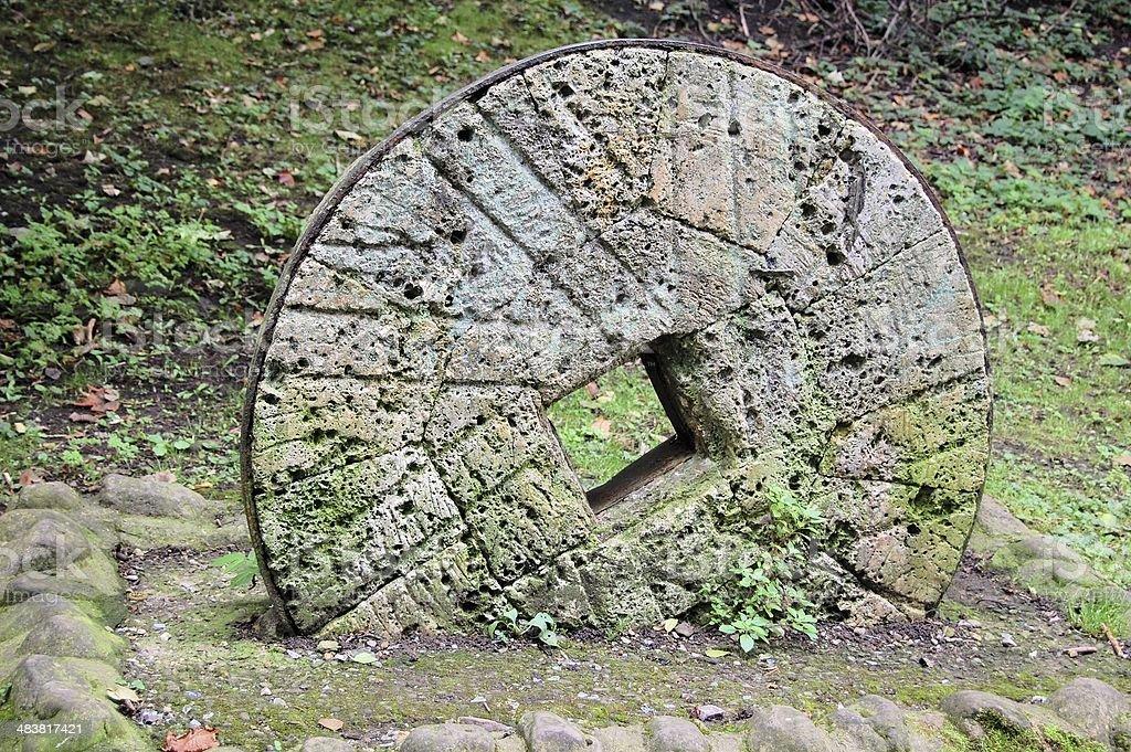 Millstone alongside the River Swale, Richmond, Yorkshire, UK stock photo
