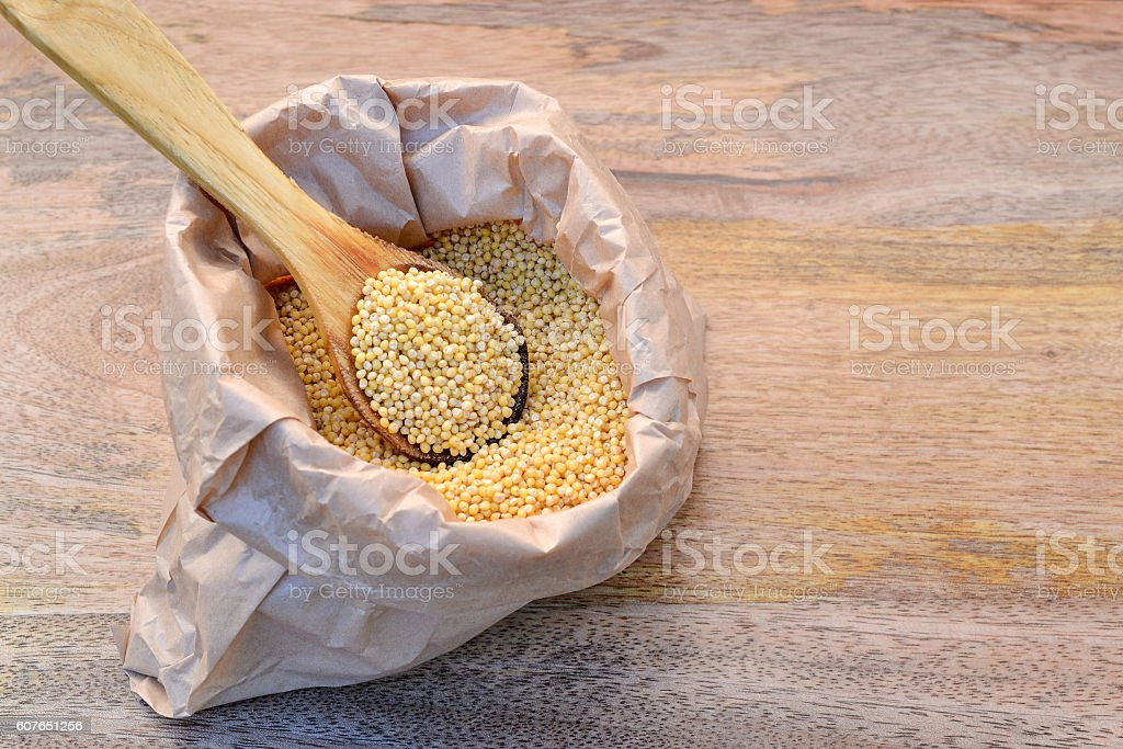 Milltet in papper bag stock photo
