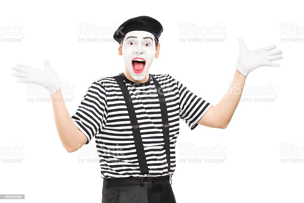 Mime artist gesturing joy with his hands stock photo