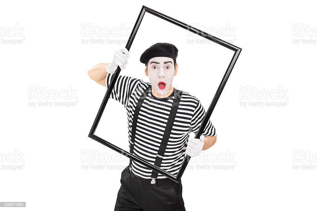 Mime artist performing with a picture frame stock photo