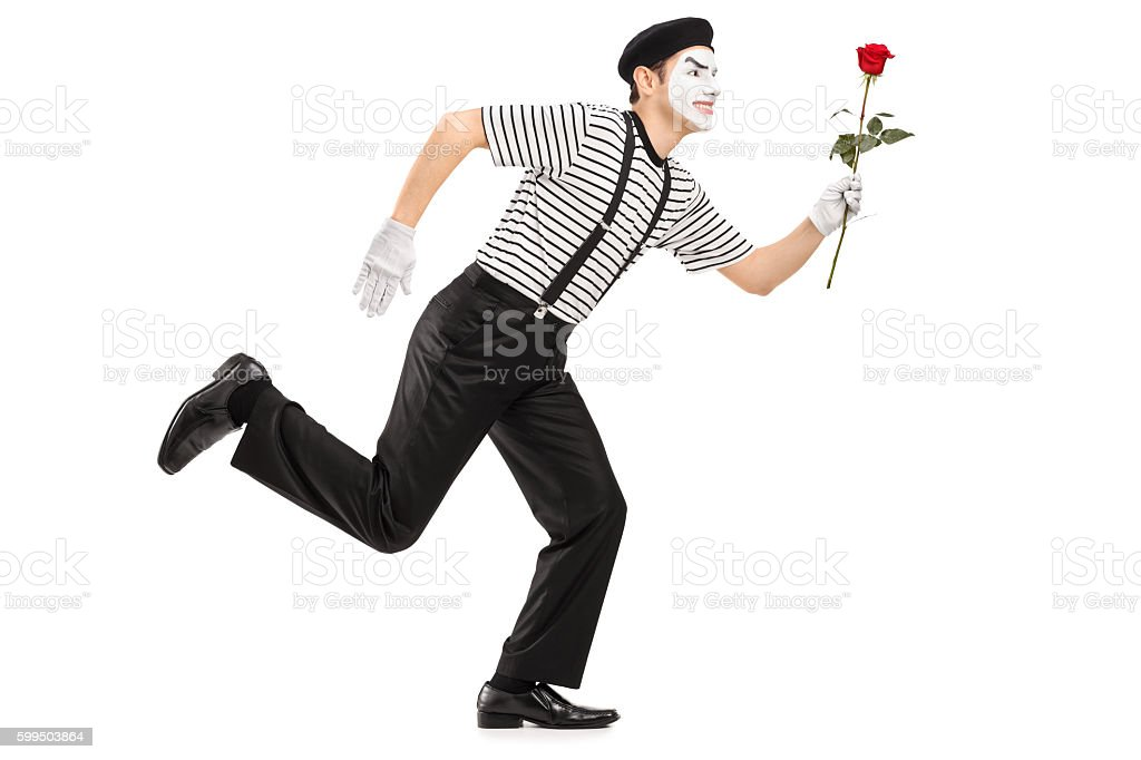 Mime artist running and holding a rose flower stock photo