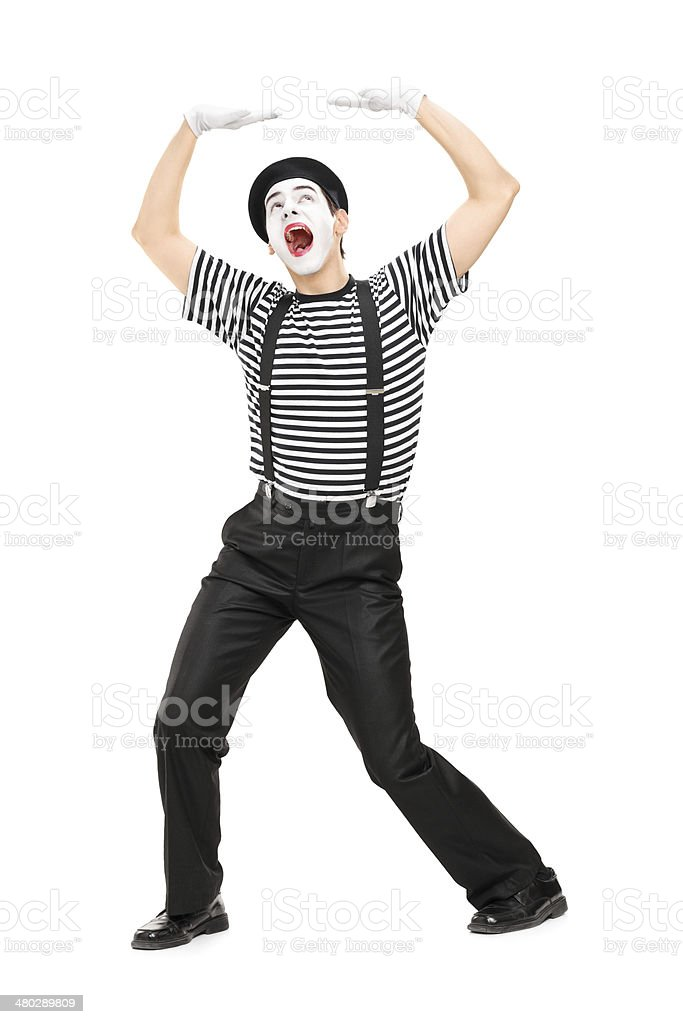 Mime artist simulate carrying something over his head stock photo