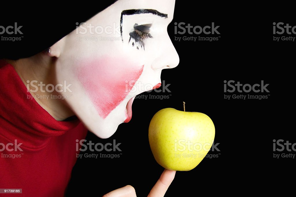 mime biting an apple royalty-free stock photo