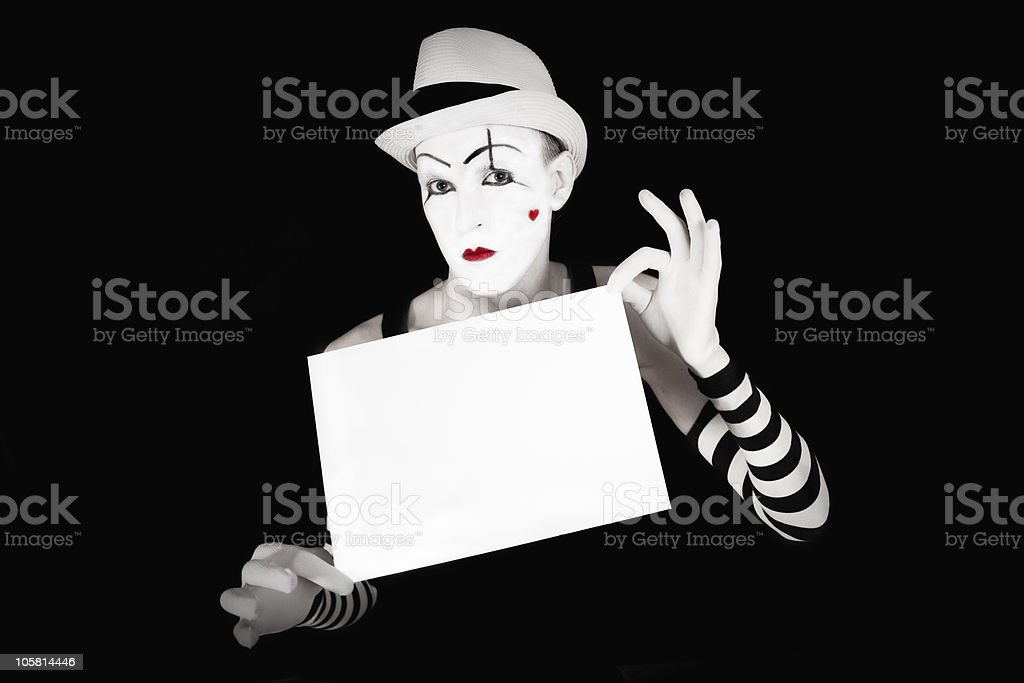 mime in striped gloves and hat, holding a white  blank stock photo