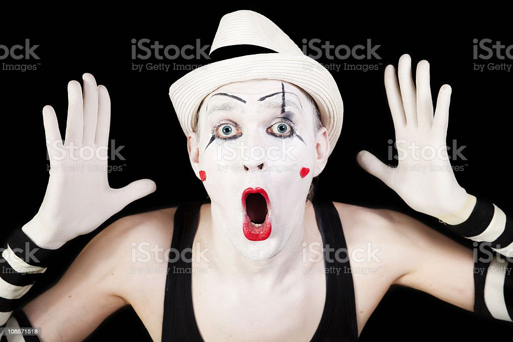 mime in striped gloves and white hat royalty-free stock photo