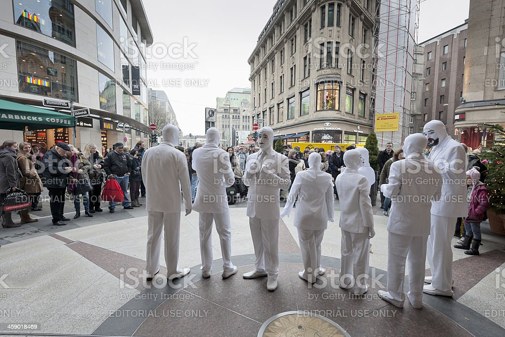 mime players performing outside Schadow Arkaden in Dusseldorf Germany stock photo