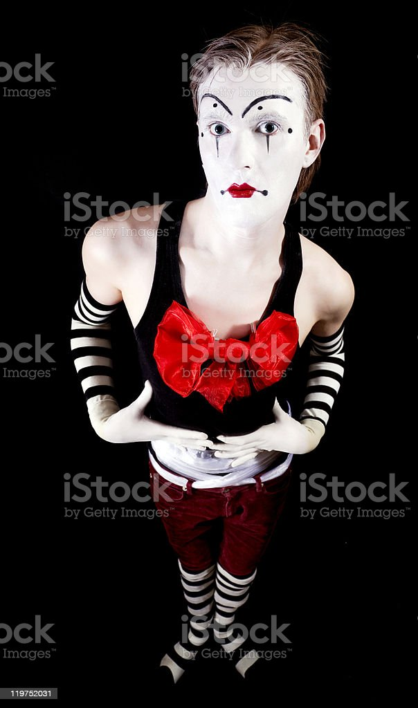 Mime with a red bow in striped socks and gloves royalty-free stock photo