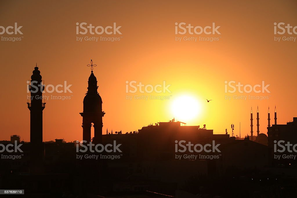 minaret and bell tower stock photo