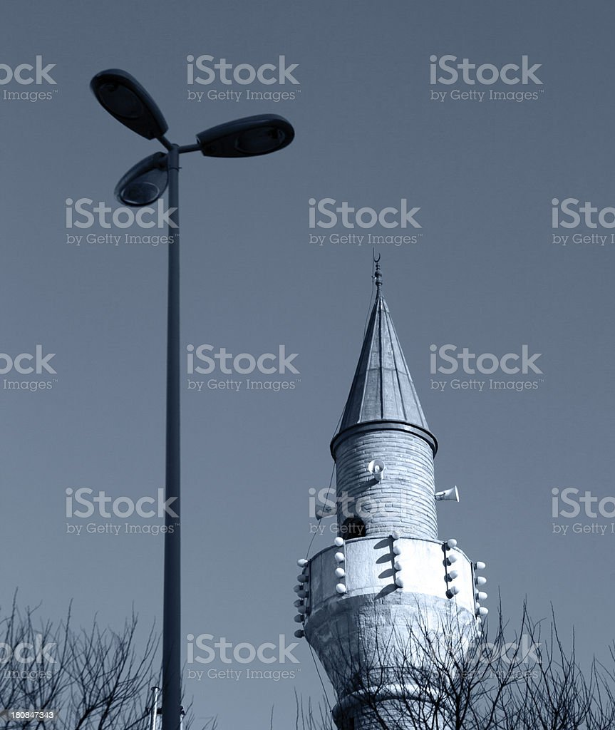 Minaret and street light. stock photo