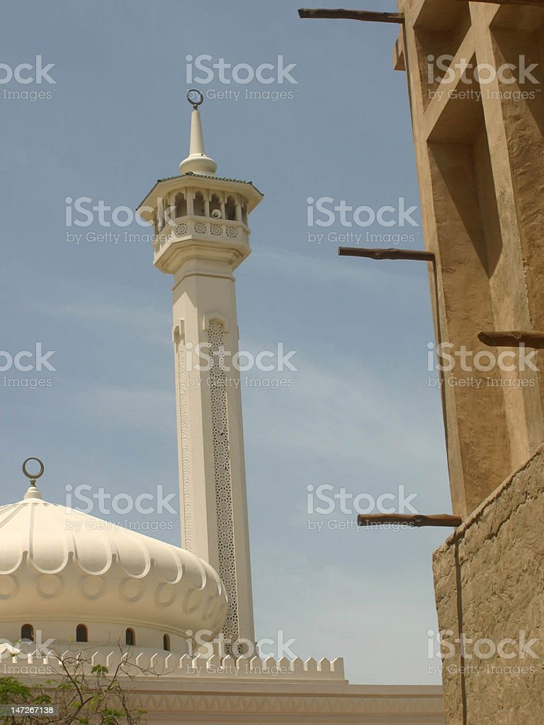 Minaret of a mosque framed by traditional Arab houses, Dubai royalty-free stock photo
