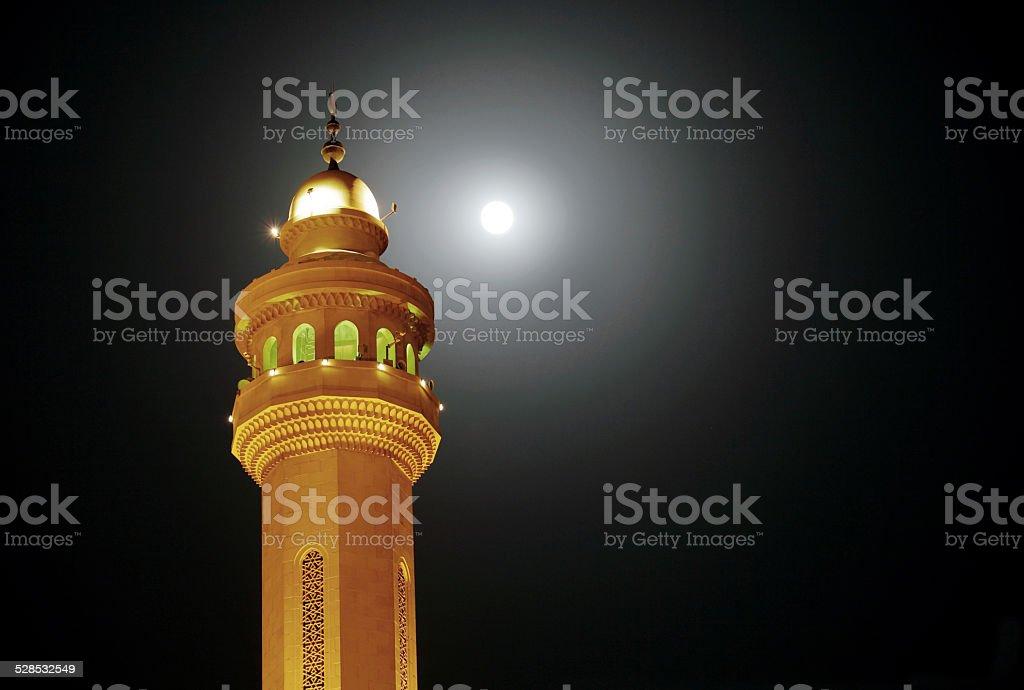 Minaret of Al Fateh Mosque & super moon stock photo
