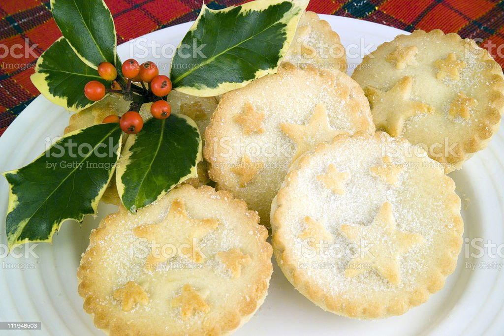 Mince pies and holly sprig on tartan cloth stock photo
