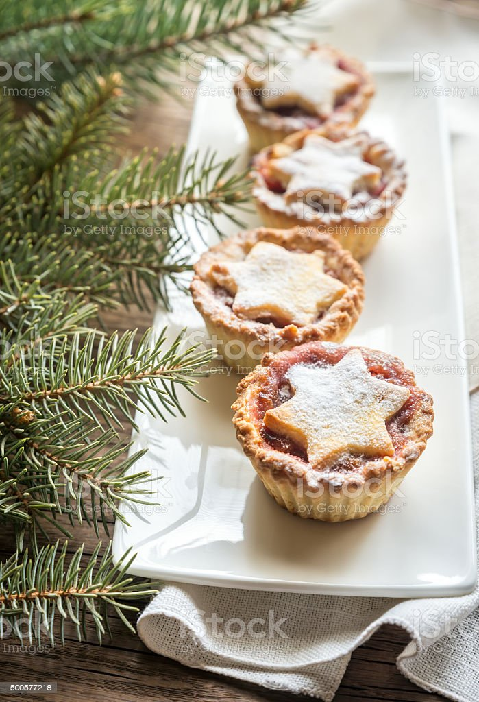Mince pies with Christmas tree branch stock photo