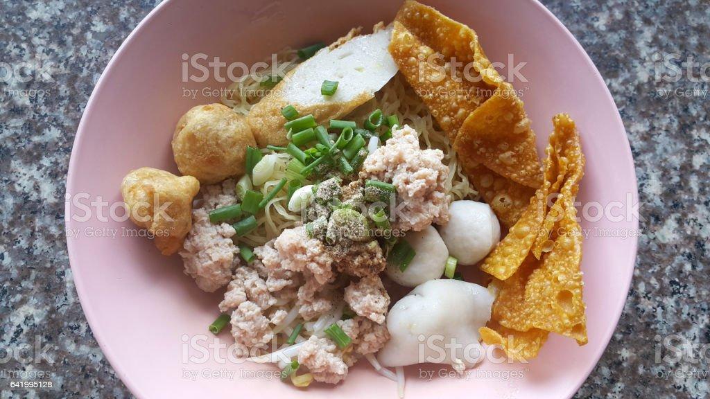 Mince pork noodle with sevaral fish balls and crispy wonton stock photo