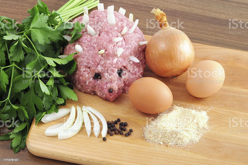 minced ground meat in Hedgehog form onions pepper parsley eggs stock photo