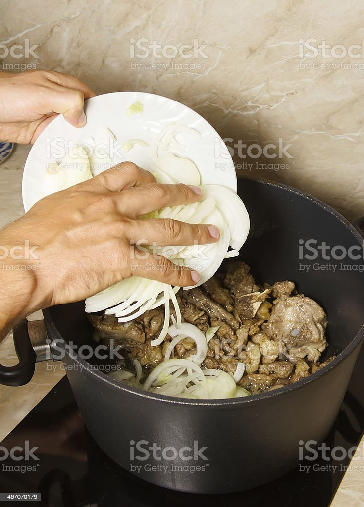 Minced meat and chopped onions frying on pan royalty-free stock photo