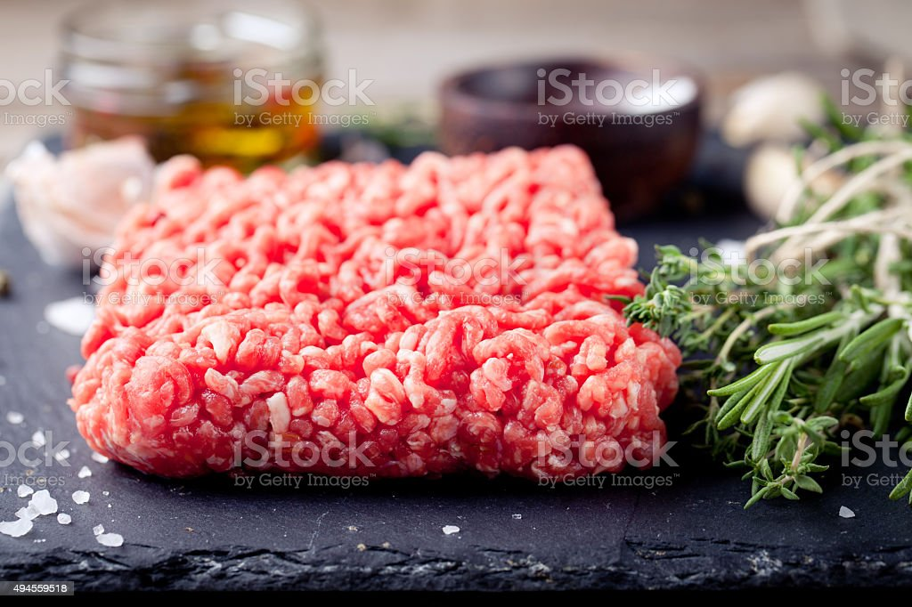 Minced meat on a slate stone black board. stock photo