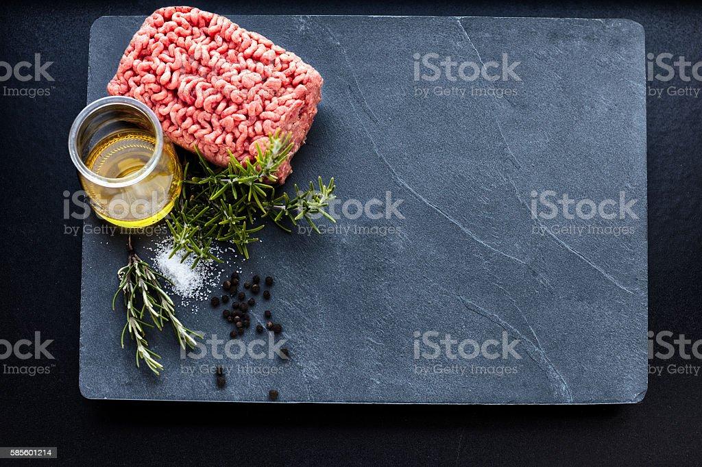 Minced meat on a slate stone stock photo
