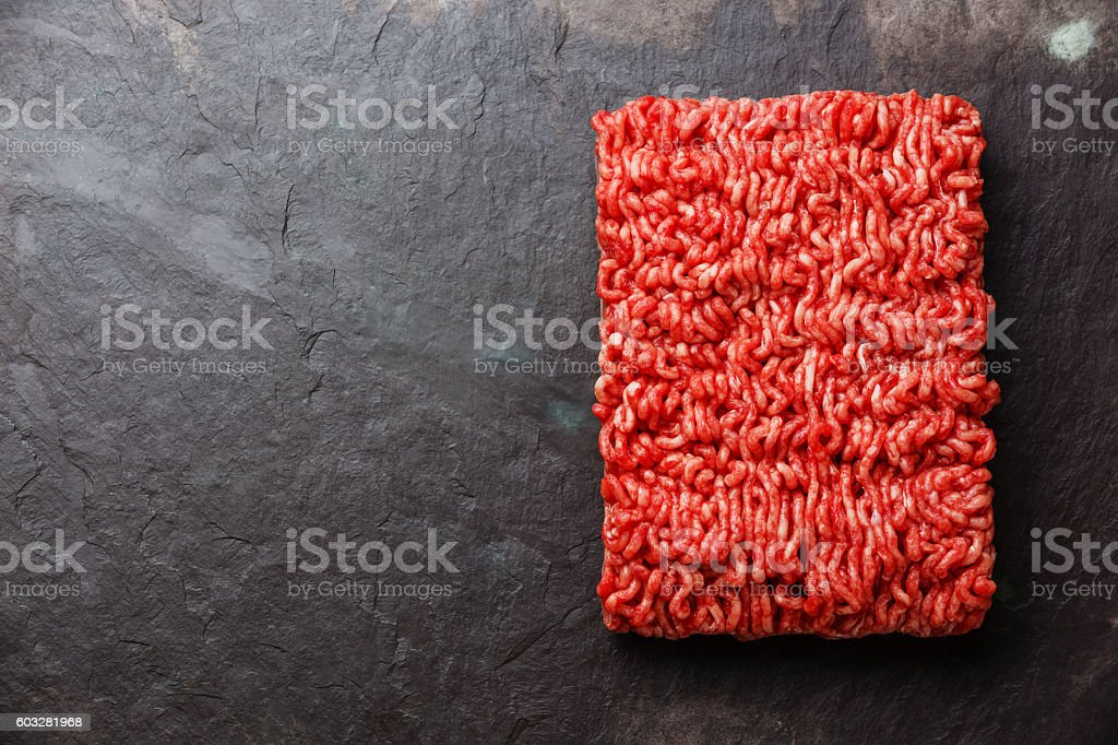 Minced meat on stone background stock photo