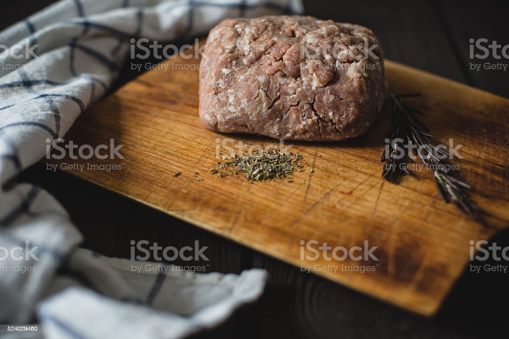 minced meat on wooden table stock photo